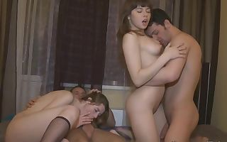 Probing a bed with foursome sex